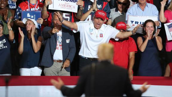 ESTERO, FL - OCTOBER 31:  People cheer as President Donald Trump looks at them during a campaign rally at the Hertz Arena to help Republican candidates running in the upcoming election on October 31, 2018 in Estero, Florida. President Trump continues travelling across America to help get the vote out for Republican candidates running for office.  (Photo by Joe Raedle/Getty Images)