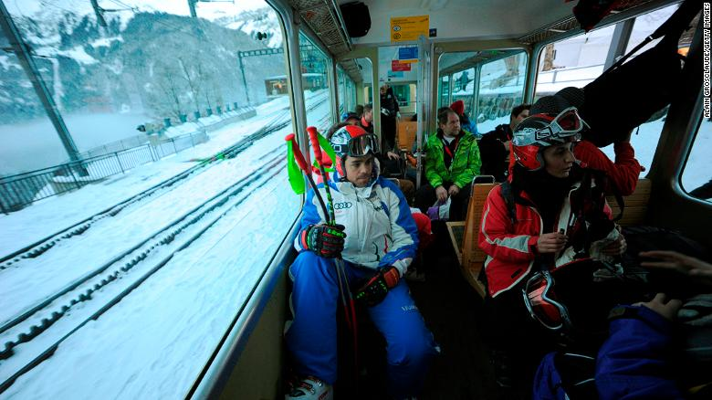 Racers travel up the mountain on a rack railway from Wengen. One-way tickets are all they need.