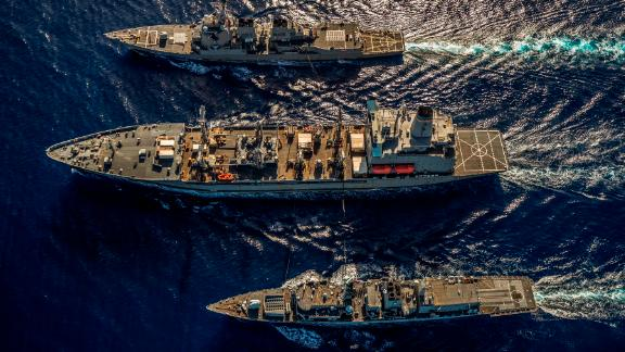 Pictured: HMS Argyll takes part in a replenishment at sea with the USS McCampbell and USNS Henry J Kaiser whilst operating in the South China Sea.