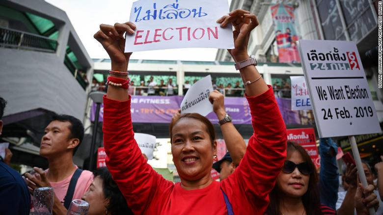 Thai anti-junta activists display placards during a demonstration against the possible delay of the country's general election, in Bangkok on January 8, 2019.