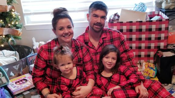 Andrew and Melisa Robinson celebrate Christmas with their two children.