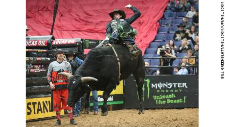 Mason Lowe rides a bull at the Scottrade Center in St. Louis, Missouri, last year.
