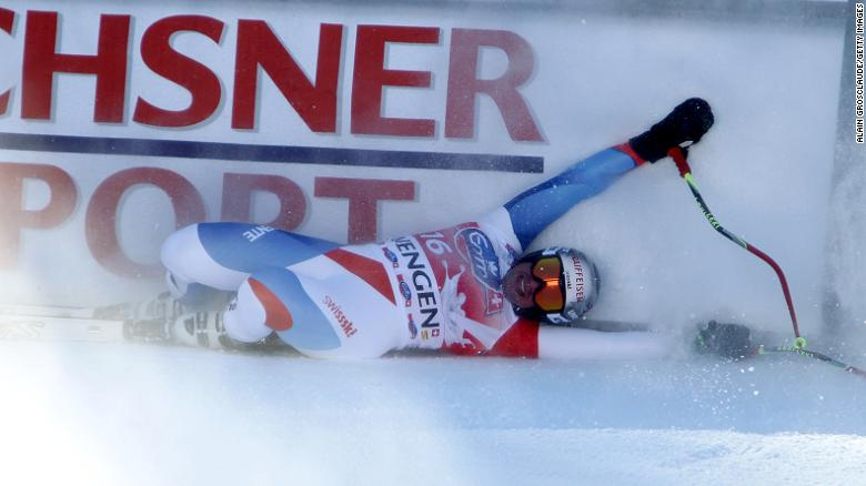 Even two-time champion Beat Feuz of Switzerland feels the physical effects of the legendary Lauberhorn at the finish.