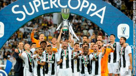 Giorgio Chiellini of Juventus lifts the trophy after winning the Italian Super Cup.
