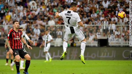 Juventus' Portuguese forward Cristiano Ronaldo heads the ball to score during their Supercoppa Italiana final between Juventus and AC Milan at the King Abdullah Sports City Stadium in Jeddah.