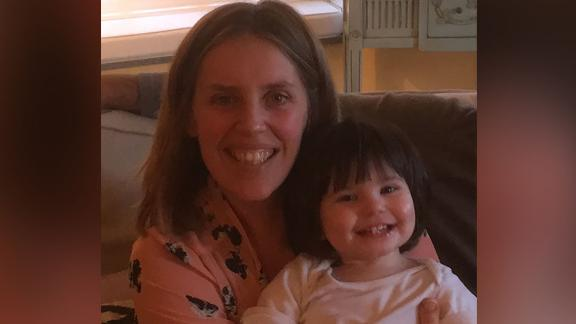 Kim Bradshaw is a surrogate. She carried the child she is pictured with, Posy, for another couple, who couldn't conceive.