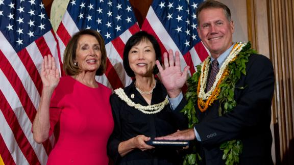 House Speaker Nancy Pelosi of Calif., administers the House oath of office to Rep. Ed Case, D-Hawaii, during ceremonial swearing-in on Capitol Hill in Washington, Thursday, Jan. 3, 2019, during the opening session of the 116th Congress. (AP Photo/Jose Luis Magana)