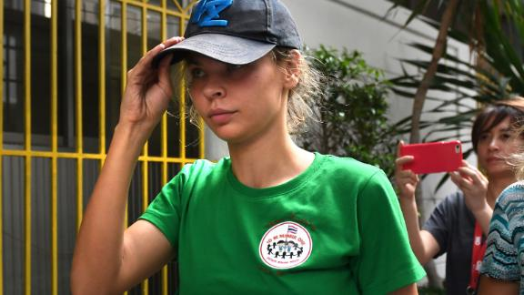 """Detained Belarusian model Anastasia Vashukevich known by her pen name Nastya Rybka arrives Thai immigration department in Bangkok on January 17, 2019 during her deportation together with other associates after pleading guilty in court to multiple charges including solicitation and illegal assembly. - A Belarusian model who claimed she had proof of Russian efforts to help Donald Trump win office is to be deported after being convicted on January 15 nearly a year after her arrest in Thailand for participating in a """"sex training course"""". (Photo by Lillian SUWANRUMPHA / AFP)        (Photo credit should read LILLIAN SUWANRUMPHA/AFP/Getty Images)"""