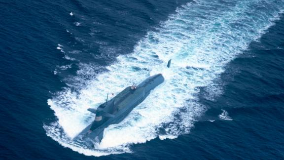 A nuclear-powered submarine of the People's Liberation Army Navy's North Sea Fleet prepares to dive into the sea.