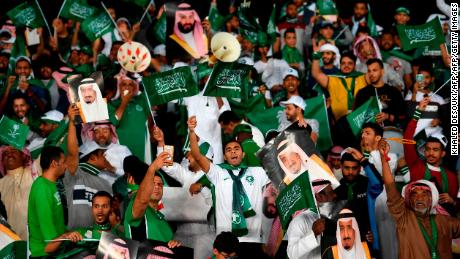 Saudi supporters cheer during the 2019 AFC Asian Cup group E football match between Saudi Arabia and Qatar.