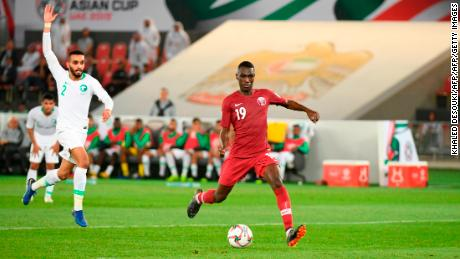 Qatar's forward Almoez Ali (R) fires home after escaping the Saudi backline.
