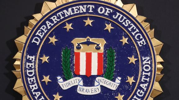 The FBI seal is attached to a podium prior to Director is Christopher A. Wray speaking at a news conference at FBI Headquarters, on June 14, 2018 in Washington, DC.
