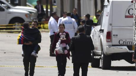 People evacuate after the blast near Bogota's Gen. Santander National Police Academy.