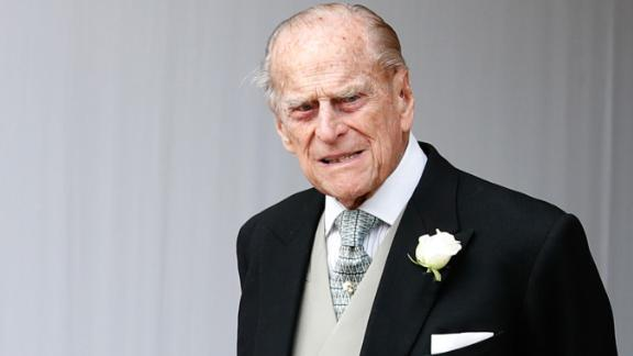 Britain's Prince Philip, Duke of Edinburgh waits for the carriage carrying Princess Eugenie of York and her husband Jack Brooksbank to pass at the start of the procession after their wedding ceremony at St George's Chapel, Windsor Castle, in Windsor, on October 12, 2018. (Photo by Alastair Grant / POOL / AFP)        (Photo credit should read ALASTAIR GRANT/AFP/Getty Images)