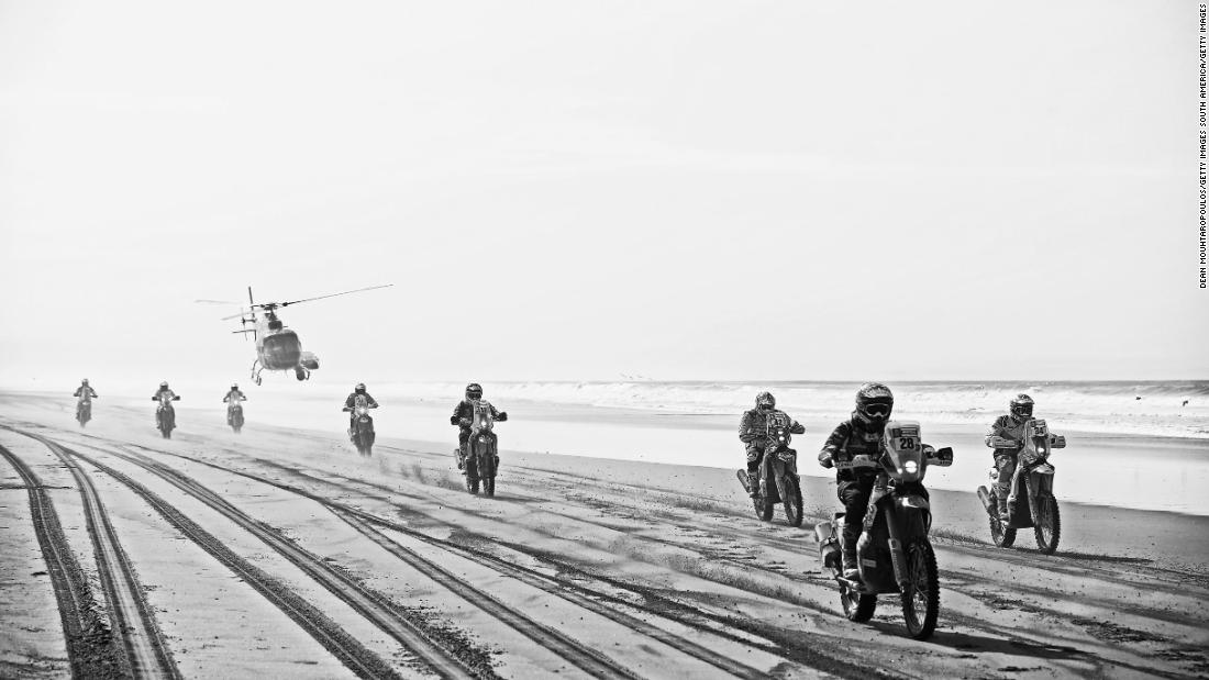 It's a race across the beach on stage five as a helicopter hovers ominously closely to the riders on the ground below.