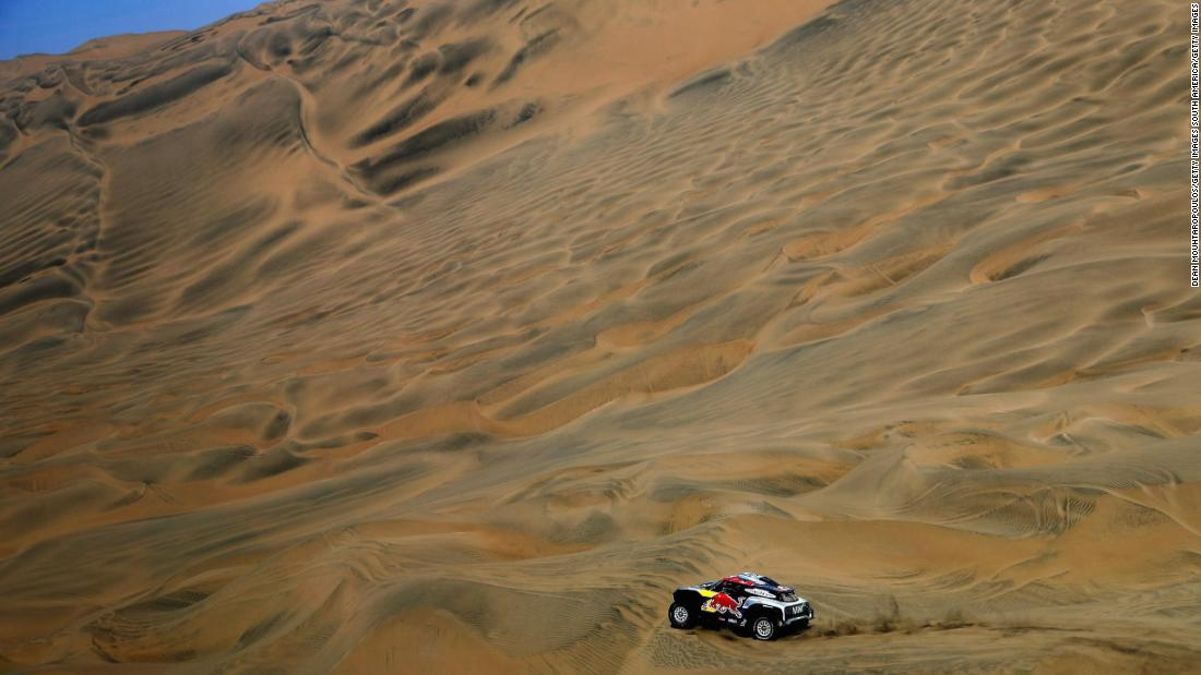 The car driven of Cyril Despres dissects the sparse landscape during stage seven of the Dakar.