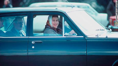 The Queen has driven since she served in the Armed Forces during World War II. Here she is pictured driving a Vauxhall estate car in Windsor Great Park during the 1970s.