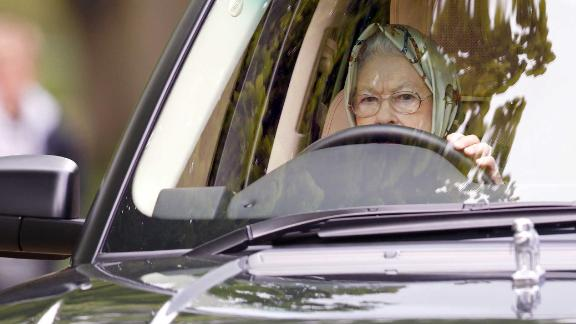 Queen Elizabeth II drives her Range Rover at the Royal Windsor Horse Show in May 2017.