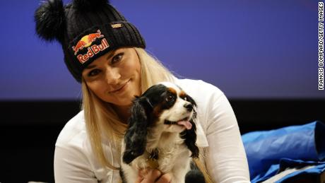 CORTINA D'AMPEZZO, ITALY - JANUARY 16 : Lindsey Vonn of USAand her dog Lucy  at a press conference during the Audi FIS Alpine Ski World Cup Women's Downhill on January 16, 2019 in Cortina d'Ampezzo Italy. (Photo by Francis Bompard/Agence Zoom/Getty Images)