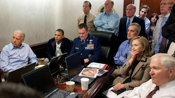 President Barack Obama and Vice President Joe Biden, along with members of the national security team, receive an update on the mission against Osama bin Laden in the Situation Room of the White House, 2011.