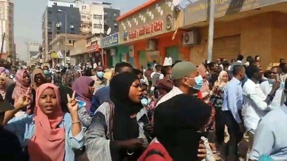 People take part in protests calling for the President's resignation in Khartoum, in an image grab taken from AFP TV on Thursday.