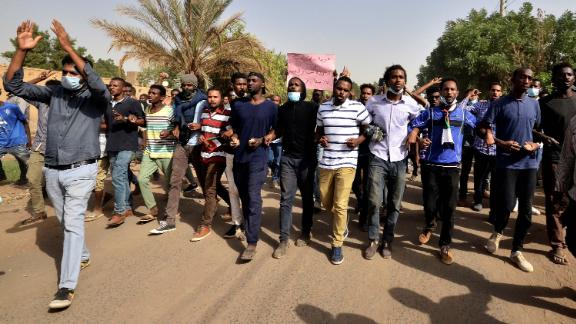 Sudanese demonstrators chant slogans as they participate in anti-government protests in Khartoum on Thursday.