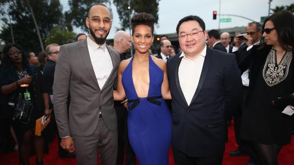 Jho Low attends the 2014 Grammy Awards alongside producer Swizz Beatz and musician Alicia Keys. Low was chairman of EMI Music Publishing Asia at the time.