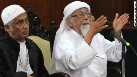 Indonesian cleric Abu Bakar Bashir, right, gestures during a court appearance in 2016.