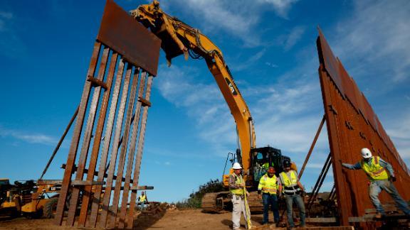Construction crews install new border wall sections on January 9, seen from Tijuana, Mexico.