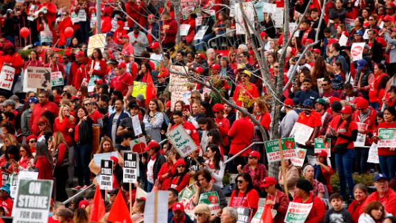 Teachers, parents and students gather Friday near Los Angeles City Hall.