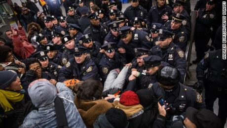 In this December 2014 image, New York police clash with demonstrators protesting the decision not to indict the officer involved in the chokehold death of Eric Garner.