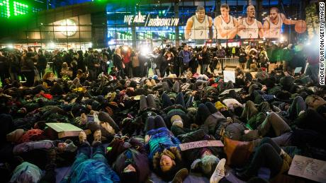 "Demonstrators stage a ""die-in"" outside the Barclays Center in Brooklyn, New York, in 2014 over the Eric Garner case."