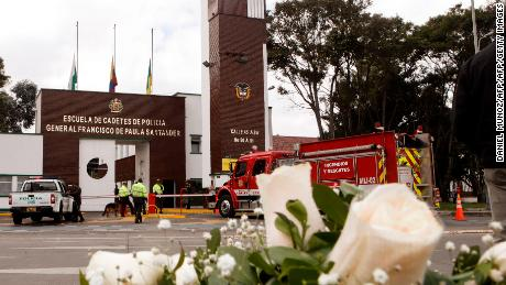 Floral tributes left to the victims of a car bomb attack at the police academy in Bogota.