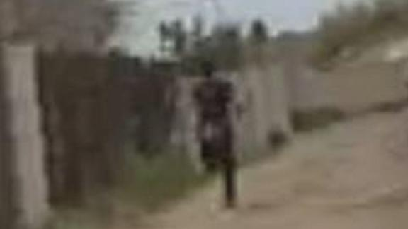 Video from the body camera worn by the officer shows the 14-year-old running away before he was shot.