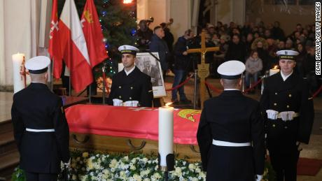 Ceremonial guards stand by the coffin of Pawel Adamowicz during a Catholic mass at St. Mary's Basilica following a procession through Gdansk on Friday.