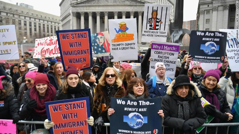 Protesters hold signs during the Women's Unity Rally at Foley Square on January 19, 2019 in New York City. (Photo by Angela Weiss / AFP) (Photo credit should read ANGELA WEISS/AFP/Getty Images)