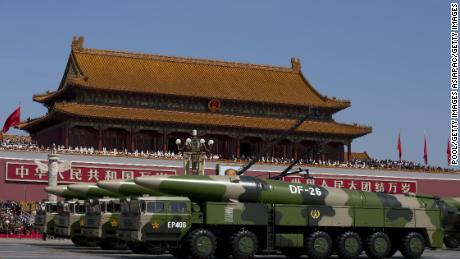 Chinese military vehicles carrying DF-26 ballistic missiles are seen during a 2015 military parade in Beijing.