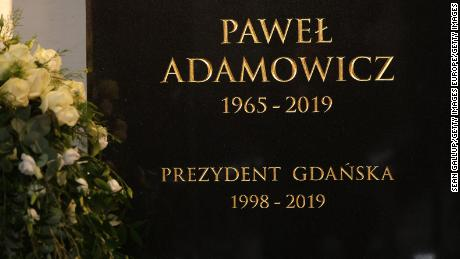The tombstone of Gdansk Mayor Pawel Adamowicz hangs on a wall prior to his funeral in St. Mary's Basilica, Gdansk, on Saturday.