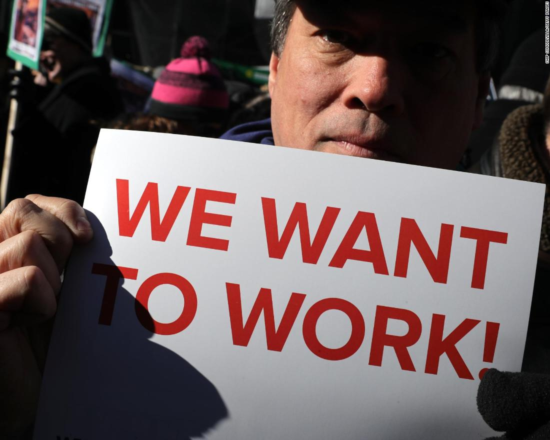 Federal workers and contractors rally against the government shutdown outside the AFL-CIO headquarters in Washington on Thursday, January 10.