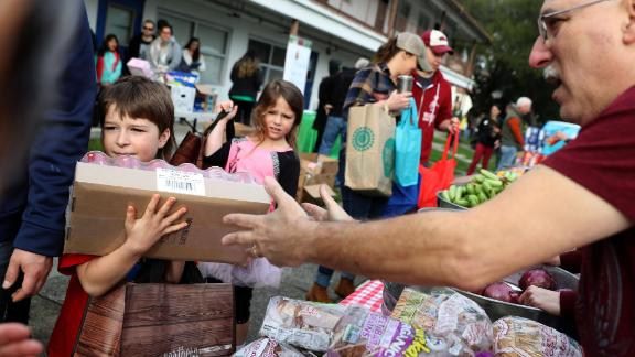 US Coast Guard families receive free groceries during a food giveaway in Novato, California, on Saturday, January 19. Thousands of active-duty Coast Guard members weren