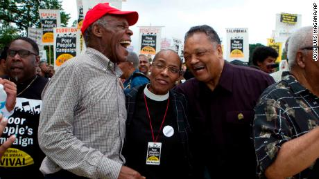 Actor Danny Glover, left, and the Rev. Jesse Jackson, right, march with others outside the US Capitol during the Poor People's Campaign rally in Washington on June 23, 2018.
