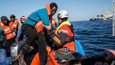 A group of 47 migrants is transfered from a rescued unflatable boat onto a Sea Watch 3 RHIB (Rigid Hull Inflatable Boat) during a rescue operation by the Dutch-flagged vessel Sea Watch 3 (Rear R) off Libya's coasts on January 19, 2019. - The German charity group Sea Watch said on January 19 that it had rescued 47 migrants from an inflatable boat, but it was not known if they belonged to the same group that was feared missing off the Libyan coast, the International Organization for Migration said on January 19 after the Italian navy flew three survivors to the Mediterranean island of Lampedusa. (Photo by FEDERICO SCOPPA / AFP)        (Photo credit should read FEDERICO SCOPPA/AFP/Getty Images)