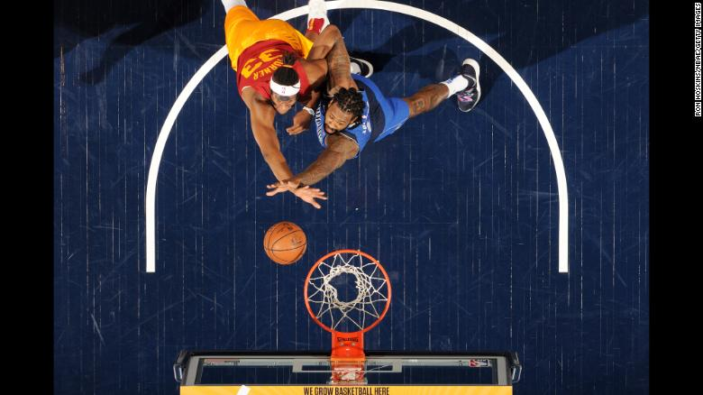 Myles Turner of the Indiana Pacers, left, and DeAndre Jordan of the Dallas Mavericks compete for a rebound during an NBA game on Saturday, January 19 at Bankers Life Fieldhouse in Indianapolis.