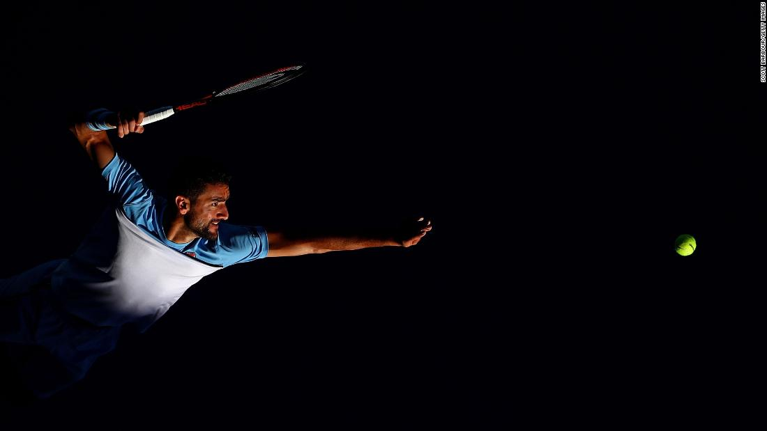 Marin Cilic serves during a match against Roberto Bautista on day seven of the Australian Open in Melbourne on Sunday, January 20.