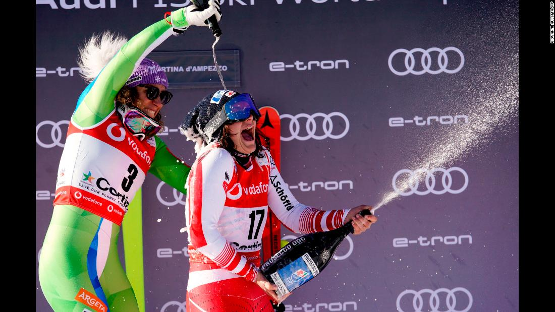 Austria's Ramona Siebenhofer, right, celebrates her World Cup downhill victory with second-place finisher Ilka Stuhecin in Cortina D'Ampezzo, Italy, on Friday, January 18.