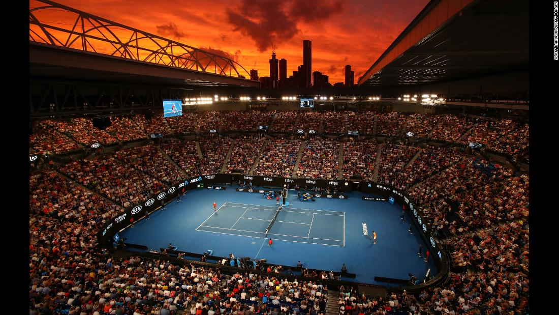 The sun sets over Rod Laver Arena during a tennis match between Alex De Minaur and Rafael Nadal on Friday, January 18 in Melbourne, Australia.