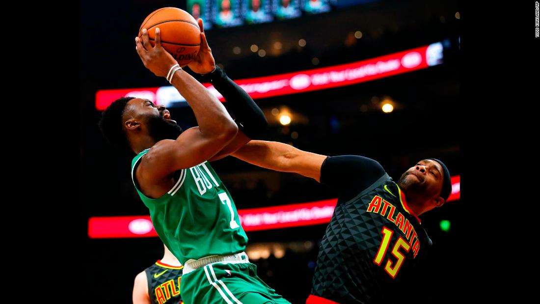 Boston Celtics guard Jaylen Brown shoots over Atlanta Hawks forward Vince Carter during the first half of an NBA  game on Saturday, January 19.
