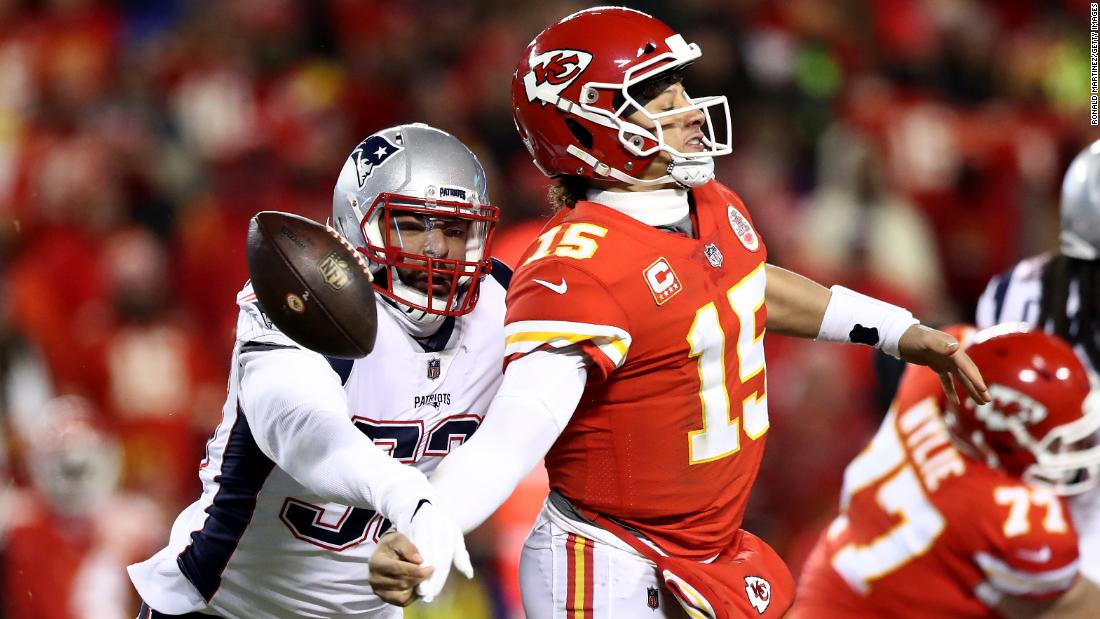 Patrick Mahomes of the Kansas City Chiefs fumbles the ball as he is hit by New England Patriots' Kyle Van Noy during the second quarter of the AFC Championship game at Arrowhead Stadium on Sunday, January 20.