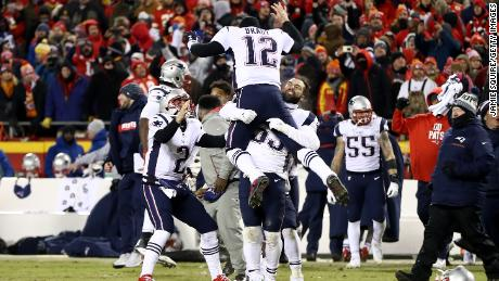 dd8a2a9a232 Tom Brady of the New England Patriots celebrates with teammates after  defeating the Kansas City Chiefs