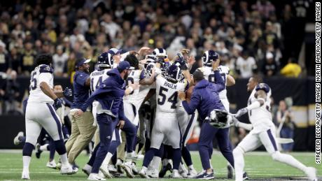 The Los Angeles Rams celebrate after kicking the game winning field goal in overtime against the New Orleans Saints in the NFC Championship game.